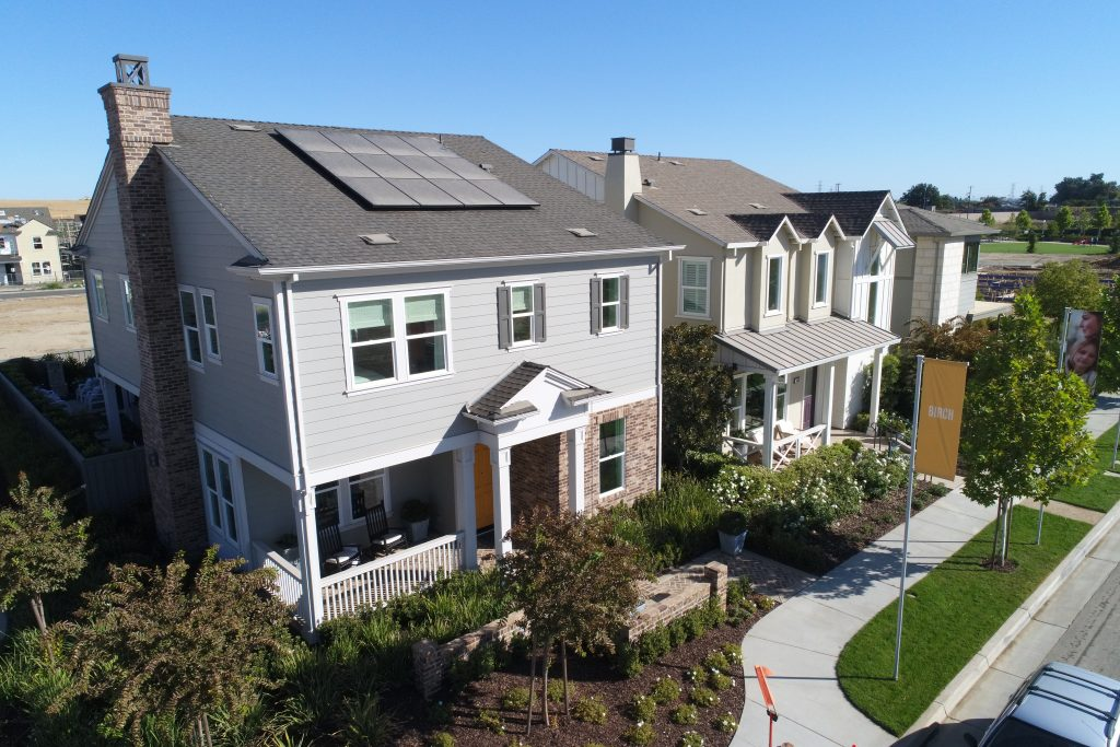 aerial view of row of new construction single family homes used for marketing